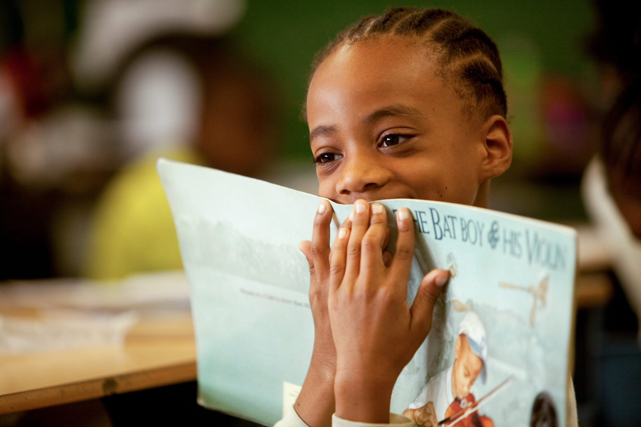 A young reader in the ExpandED Schools network reflects on a story. Photo by Jim Burger