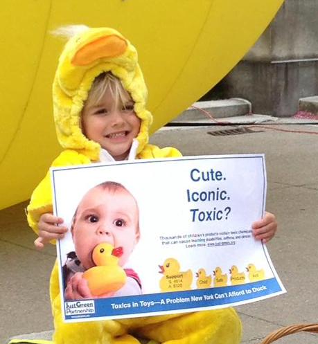 A child protests harmful chemicals in children's toys.
